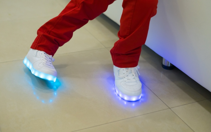 boy wearing glowing white led sneakers; Shutterstock ID 622824854; Usage (Print, Web, Both): web; Issue Date: 4/9