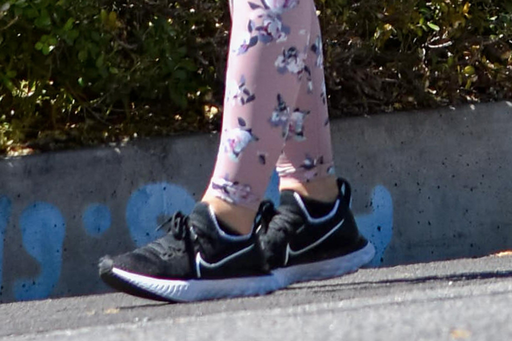 lucy hale, style, walk, crop top, dog, leggings, flowers, mask, apl sneakers, nike