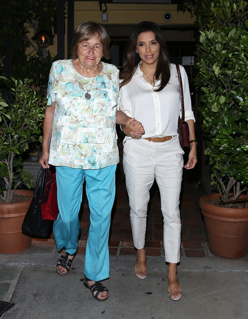 """Eva Longoria, white pants, white blouse, see through sandals, manolo blahnik shoes, celebrity style, fashion, street style, holds her mothers arm as they were seen leaving dinner together at """"AGO' Italian Restaurant in West Hollywood, CA. 21 Jun 2019 Pictured: Eva Longoria. Photo credit: WPS / MEGA TheMegaAgency.com +1 888 505 6342 (Mega Agency TagID: MEGA450246_008.jpg) [Photo via Mega Agency]"""