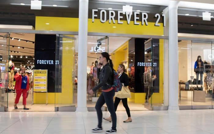 People walk in front of a Forever 21 clothing store, in New York. Low-price fashion chain Forever 21, a one-time hot destination for teen shoppers that fell victim to its own rapid expansion and changing consumer tastes, has filed for Chapter 11 bankruptcy protectionForever 21 Bankruptcy, New York, USA - 30 Sep 2019