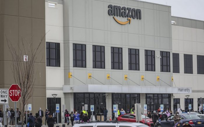 Workers at Amazon's fulfillment center in Staten Island, N.Y., gather outside to protest work conditions in the company's warehouse in New York. Amazon fired a worker who staged the walkout to demand greater protection against the new coronavirus, saying the employee himself flaunted distancing rules and put others at risk. The decision prompted a rebuke from New York Attorney General Letitia James, who called on the National Labor Relations Board to investigateVirus Outbreak Amazon, New York, United States - 30 Mar 2020