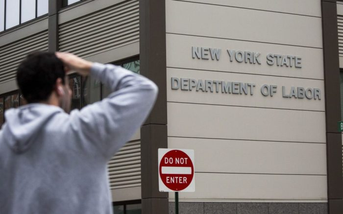 A pedestrian stands in front of the New York State Department of Labor office in the Brooklyn borough of New York, the United States, on May 8, 2020. New data showed that U.S. employers cut a staggering 20.5 million jobs in April, erasing a decade of job gains since the global financial crisis and pushing the unemployment rate to a record 14.7 percent. While this marks the highest level of unemployment since the Great Depression, analysts said the figure does not capture the full scale of the COVID-19-induced job crisis, and the worst is yet to come.u.s. New York Unemployment Covid 19 Economy - 08 May 2020