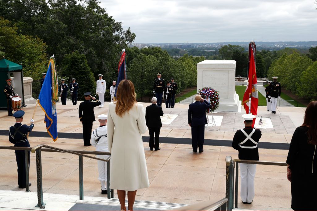 Melania Trump wore a white coat and matching pumps for a ceremony to mark Memorial Day