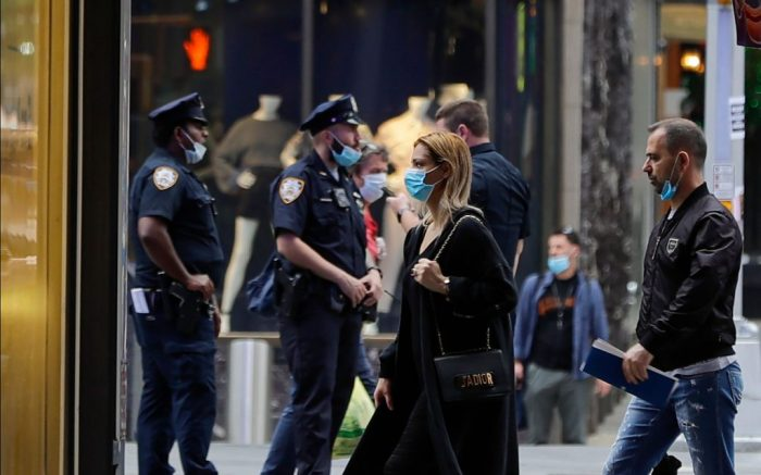 Pedestrians and Police officers wear protective masks during the coronavirus pandemic in Times Square, in New YorkVirus Outbreak , New York, United States - 28 May 2020