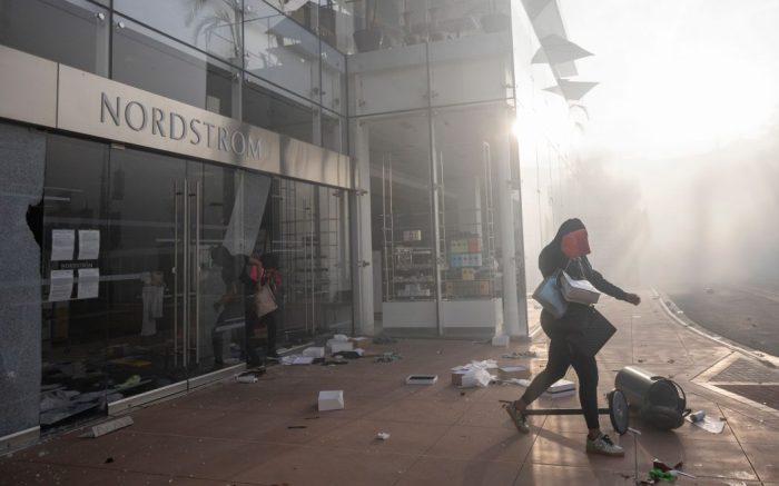 Looters run from the shattered glass doors of a Nordstrom store at The Grove shopping mall as unrest grows across the US over the Minneapolis arrest of George Floyd, who later died in police custody, in Los Angeles, California, USA, 30 May 2020. A bystander's video posted online on 25 May, appeared to show George Floyd, 46, pleading with arresting officers that he couldn't breathe as an officer knelt on his neck. The unarmed black man later died in police custody.Protest in wake of George Floyd's death, in Los Angeles, USA - 30 May 2020