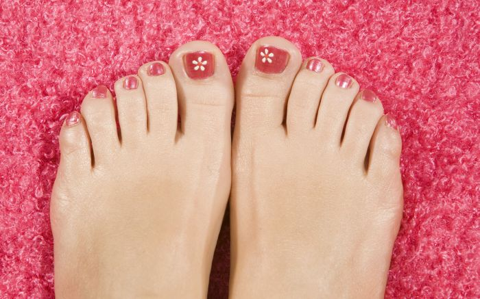 MODEL RELEASED Feet, nail varnish, painted