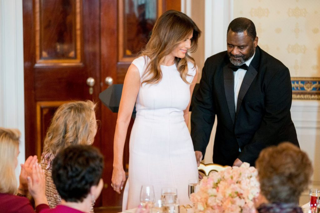First lady , Melania Trump, gabriela hearst dress, pink midi dress, sits down after speaking at a Governors' Spouses' Luncheon in the East Room of the White House, in WashingtonTrump, Washington, USA - 26 Feb 2018