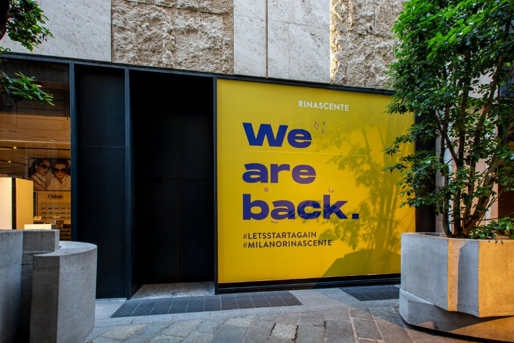 A brightly colored slogan at Rinascente in Milan, italy reopens