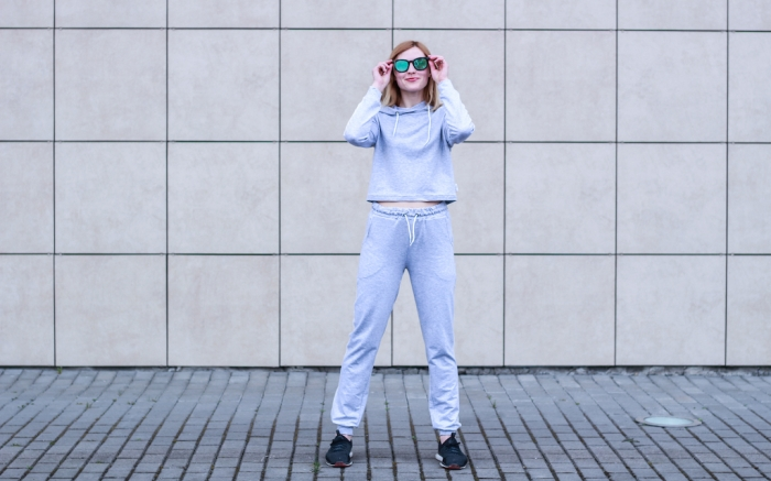 The girl is blonde in a gray sports suit. Street clothing. Sport. Advertising. Fashion and style. Trends. Mockup. Copyspace; Shutterstock ID 1428620564; Usage (Print, Web, Both): web; Issue Date: 4/9