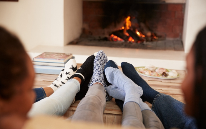 Close Up Of Feet As Family Relax Next To Open Fire; Shutterstock ID 714538324; Usage (Print, Web, Both): web; Issue Date: 4/9