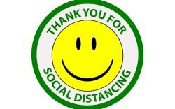 smiling sign, social distancing