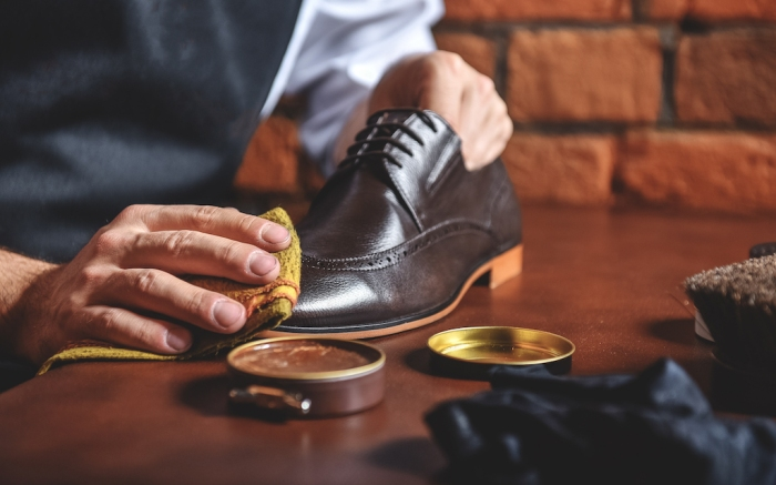 man shining shoes with a rag; Shutterstock ID 502527196; Usage (Print, Web, Both): web; Issue Date: 4/9