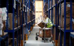 Lovespace warehouse worker Pawel Mazur unloads