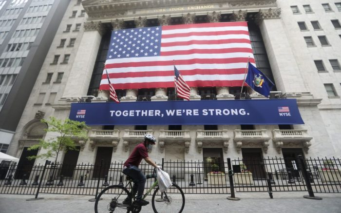 A cyclist passes by the New York Stock Exchange in New York, the United States, on May 26, 2020. The New York Stock Exchange (NYSE) partially reopened its iconic trading floor on Tuesday after a two-month closure due to the COVID-19 pandemic.u.s. New York Nyse Partial Reopening - 26 May 2020