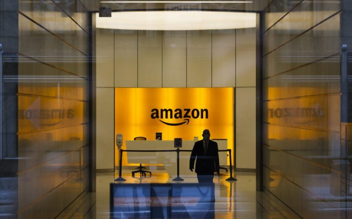 A man is seen inside the entrance to the Amazon offices in New York, New York, USA, on 27 May 2020. Restrictions requiring the shut down of all non-essential businesses are currently in place around the United States to stop the spread of the highly-contagious coronavirus, though some areas are beginning to be reopen. These restrictions are having massive economic implications and some local and federal politicians are beginning to suggest plans for lifting some rules in an effort to get parts of the economy going again; many health officials are worried this will lead to another spike in COVID-19 cases.New York Coronavirus Economy Amazon, USA - 27 May 2020