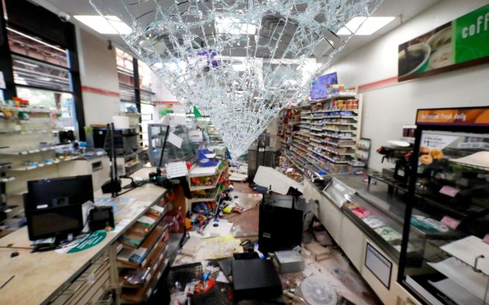 Shattered glass hangs from the doorway of a 7-Eleven store early Sunday morning, in Chicago, after a night of unrest and protests over the death of George Floyd, a black man who was in police custody in Minneapolis. Floyd died after being restrained by Minneapolis police officers on Memorial DayMinneapolis Police Death , Chicago, United States - 31 May 2020