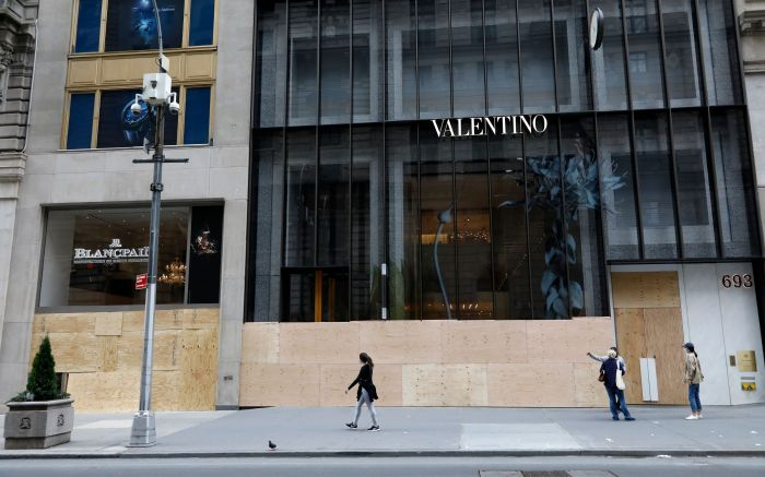 valentino, fifth avenue, People walk past the Blancpain and Valentino store boarded up windows on Fifth Avenue after looting riots a night earlier as part of the response by protesters to George Floyd's death, in New York, New York, USA, 02 June 2020. A bystander's video posted online on 25 May, shows George Floyd pleading with arresting officers that he couldn't breathe as an officer knelt on his neck. The unarmed black man soon became unresponsive, and was later pronounced dead. According to reports on 29 May, Derek Chauvin, the police officer at the center of the incident, has been taken into custody and charged with murder in the death of George Floyd.Looting Clean-up New York, USA - 02 Jun 2020