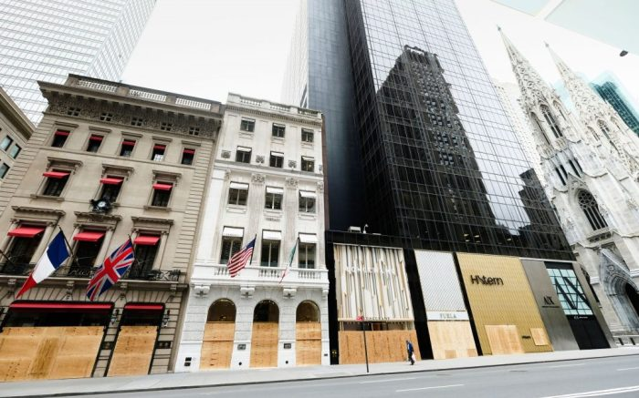 Stores on Fifth Avenue boarded up after a night of looting and and social unrest following George Floyd police brutality protests in Manhattan, in New YorkNYC Looting Aftermath, New York, United States - 02 Jun 2020