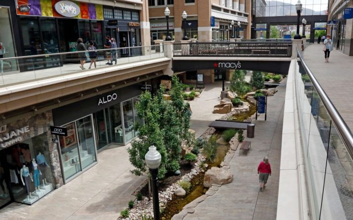 Shoppers walk through City Creek Center in Salt Lake City. Mall owner Simon Properties said that it is pulling out of its $3.6 billion to buy rival Taubman, citing the coronavirus pandemic which has forced many malls to temporarily close their doors. It is the second major retail deal to fall apart due to the pandemicVirus Outbreak Utah Malls Reopening, Salt Lake City, United States - 06 May 2020