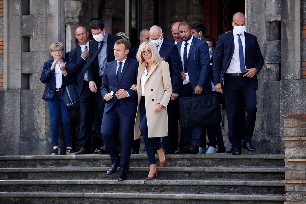 brigitte macron, trench coat, brown pumps, skinny jeans, French President Emmanuel Macron (L) and his wife Brigitte Macron (R) wave to people as they leave a polling station in Le Touquet, France, 28 June 2020. The second round of municipal elections was to be held on 22 March 2020 but was delayed due to the spread of the coronavirus pandemic causing the Covid-19 disease.French municipal election in Le Touquet, France - 28 Jun 2020