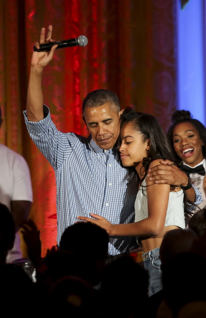 US President Barack Obama hugs his daughter Malia, after singing to her Happy Birthday, at the Fourth of July White House party, while singer Janelle Monae (R) reactsWhite House Independence Day party, Washington, D.C, America - 04 Jul 2016Guests at the party included military families and staff and their families from throughout the administration. Because of the rain the party was moved from the South Lawn to the East Room of the White House.US President Barack Obama hugs his daughter Malia, after singing to her Happy Birthday, at the Fourth of July White House party, while singer Janelle Monae (R) reactsWhite House Independence Day party, Washington, D.C, America - 04 Jul 2016Guests at the party included military families and staff and their families from throughout the administration. Because of the rain the party was moved from the South Lawn to the East Room of the White House.