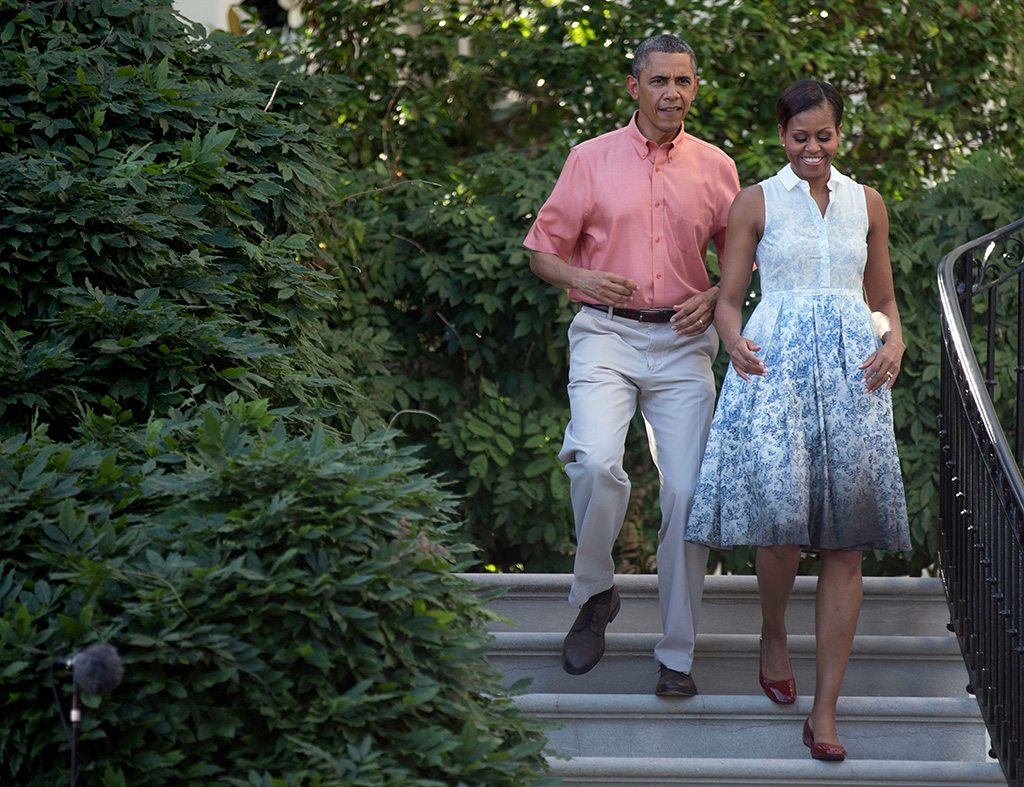 Barack Obama, Michelle Obama, Boy. by Band of Outsiders dress, President Barack Obama, right, and first lady Michelle Obama walk down the South Portico steps during a Fourth of July celebration with members of the military and their families on the South Lawn of the White House in WashingtonObama Fourth of July, Washington, USABarack Obama, Michelle Obama President Barack Obama, right, and first lady Michelle Obama walk down the South Portico steps during a Fourth of July celebration with members of the military and their families on the South Lawn of the White House in WashingtonObama Fourth of July, Washington, USA