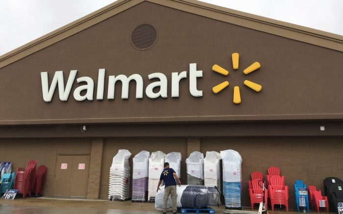 A worker stacks merchandise outside a Walmart in Salem, N.H. Walmart is providing workers with an app aimed at helping them budget their money and get paid before paydayWalmart-Worker Finances, Salem, USA - 05 Jun 2017