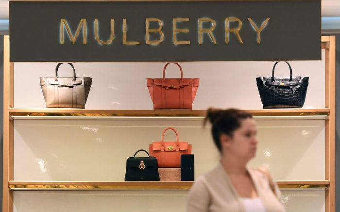 A customer walks past Mulberry luxury handbags at a House of Fraser store in London, Britain, 20 August 2018. According to news reports Mulberry shares have fallen by thirty per cent in the wake of the House of Fraser's troubles.Mulberry shares fall some thirty per cent in wake of House of Fraser's restructuring, London, United Kingdom - 20 Aug 2018