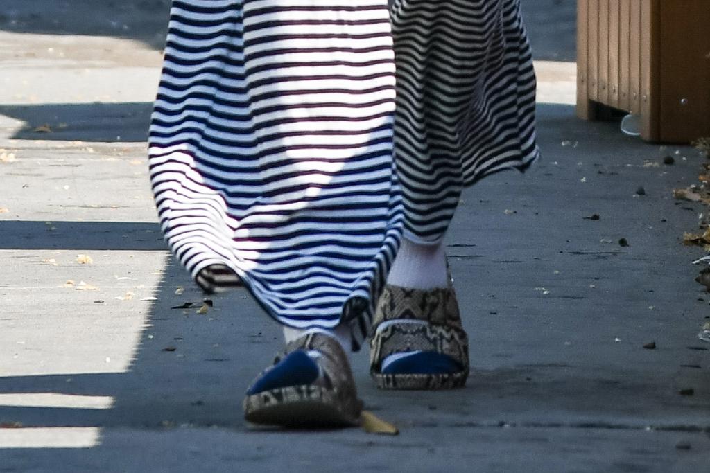whitney port, los angeles, stripe pants, mask, socks, slides, sandals, snakeskin