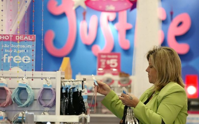 Michelle Silonuk shops for her two daughters at a Justice store Tuesday, Aug. 15, 2006, in Columbus, Ohio. (AP Photo/Jay LaPrete)