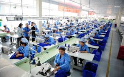 --FILE--Female Chinese workers sew clothes at