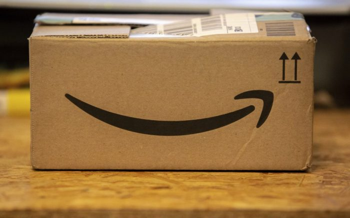 The logo of Amazon on the cardboard box of a package on a table.(Sipa via AP Images)