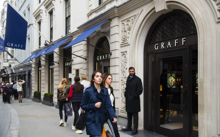 Shoppers walk past the Graff store in New Bond Street in London,UK on October 3, 2019. (Photo by Claire Doherty/Sipa USA)(Sipa via AP Images)