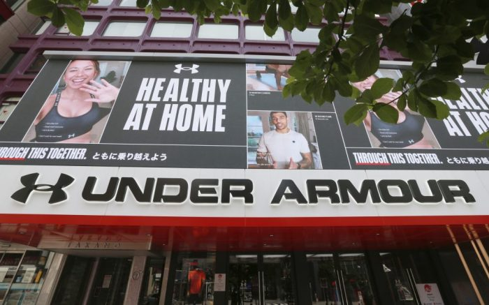 The logo of Under Armour, Inc. is seen in Shinjuku Ward, Tokyo on May 5, 2020. Under Armour is an American company that manufactures footwear, sports, and casual apparel. ( The Yomiuri Shimbun via AP Images )