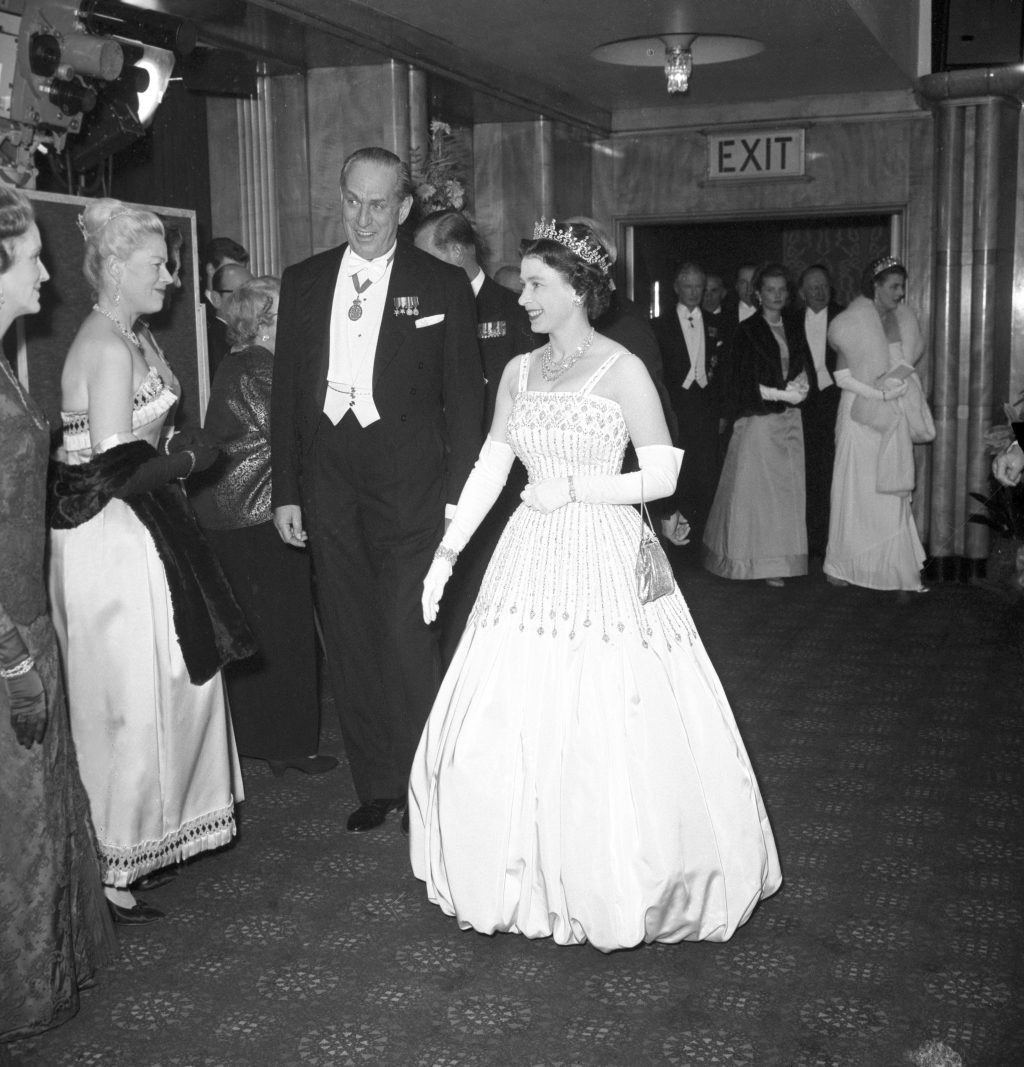 Princess Beatrice wedding. File photo dated 10/12/62 of Queen Elizabeth II arriving at the Odeon, Leicester Square, London for the world charity premiere of the film 'Lawrence of Arabia'. The Queen is wearing the same Peau De Soie taffeta dress by Norman Hartnell that was worn by Princess Beatrice at her wedding to Edoardo Mapelli Mozzi on Friday. Issue date: Saturday July 18, 2020. See PA story ROYAL Beatrice. Photo credit should read: PA/PA Wire URN:54642674 (Press Association via AP Images)