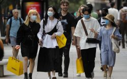 Shoppers wear face coverings to protect