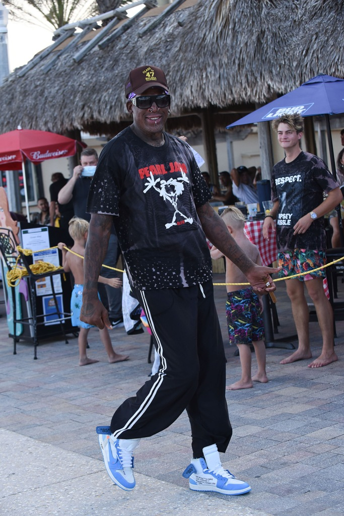 dennis rodman, off-white x nike sneakers, off-white jordans, unc jordans, track pants, baseball cap, NBA legend Dennis Rodman parties on the busy Hollywood Beach Boardwalk with no masks or social distancing as Florida's Covid cases soar. The former basketball ace was spotted kicking back on Sunday Funday (july 19) with bikini clad galpal seemingly without a care in the world despite the raging virus. he was seen taking selfies with approaching fans - young and old - and enjoying outside dining with his group. Broward County is now under nightly curfew after an emergency order was issued amid record highs in the state. Florida reported more than 12,400 new cases Sunday, bringing its total to more than 350,000.Pictured: Dennis RodmanRef: SPL5177860 200720 NON-EXCLUSIVEPicture by: Michele Eve Sandberg / SplashNews.comSplash News and PicturesUSA: +1 310-525-5808London: +44 (0)20 8126 1009Berlin: +49 175 3764 166photodesk@splashnews.comWorld RightsNBA legend Dennis Rodman parties on the busy Hollywood Beach Boardwalk with no masks or social distancing as Florida's Covid cases soar. The former basketball ace was spotted kicking back on Sunday Funday (july 19) with bikini clad galpal seemingly without a care in the world despite the raging virus. he was seen taking selfies with approaching fans - young and old - and enjoying outside dining with his group. Broward County is now under nightly curfew after an emergency order was issued amid record highs in the state. Florida reported more than 12,400 new cases Sunday, bringing its total to more than 350,000.Pictured: Dennis RodmanRef: SPL5177860 200720 NON-EXCLUSIVEPicture by: Michele Eve Sandberg / SplashNews.comSplash News and PicturesUSA: +1 310-525-5808London: +44 (0)20 8126 1009Berlin: +49 175 3764 166photodesk@splashnews.comWorld Rights