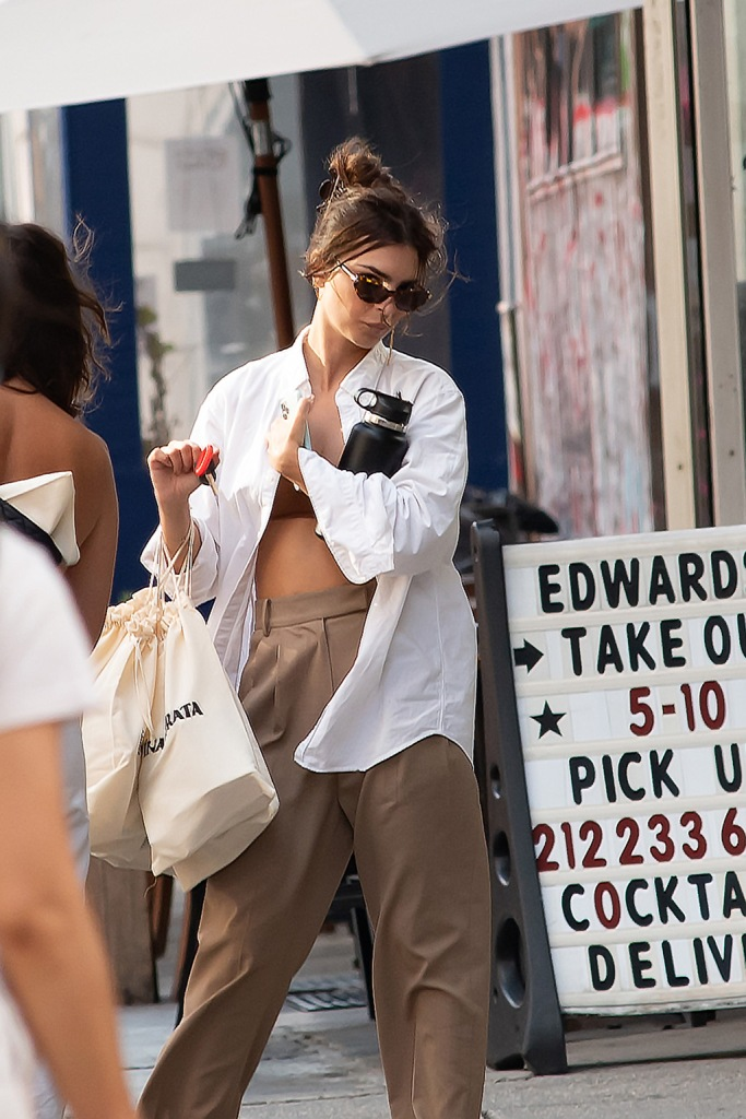 Emily Ratajkowski , bra, button-down shirt, abs, high-waisted trousers, street style, Spotted in NYCTribeca, NYPictured: Emily RatajkowskiRef: SPL5179202 280720 NON-EXCLUSIVEPicture by: Janet Mayer / SplashNews.comSplash News and PicturesUSA: +1 310-525-5808London: +44 (0)20 8126 1009Berlin: +49 175 3764 166photodesk@splashnews.comWorld Rights