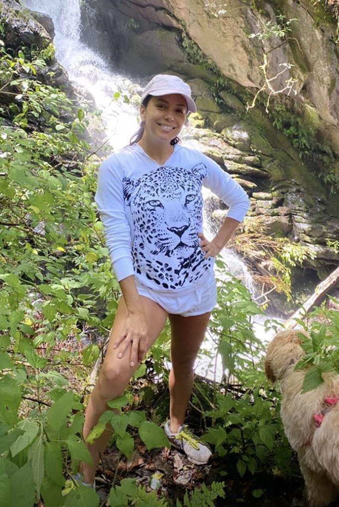 Eva Longoria, leopard sweatshirt, baseball cap, new balance sneakers,