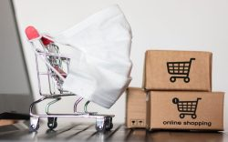 Shopping cart and packages representing e-commerce