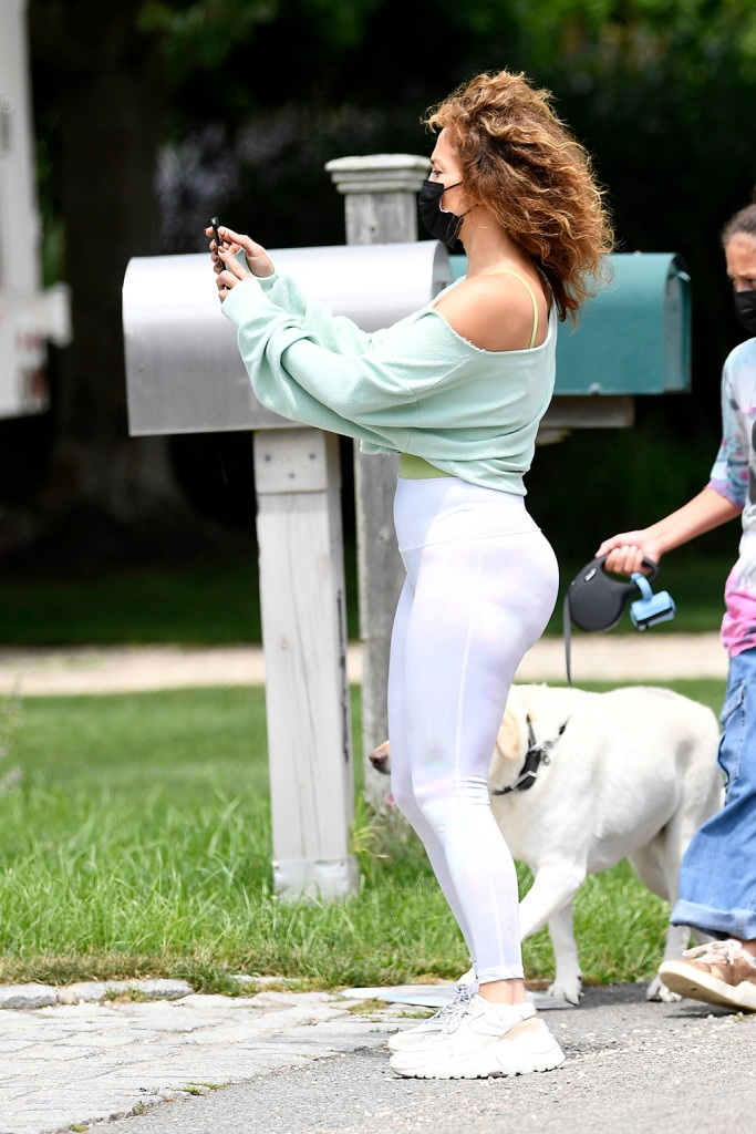 Jennifer Lopez, leggings, legs, last sprint sneakers, cropped sweatshirt, tank top, street style, steps out for a morning walk in Water Mill hamtpons New YorkPictured: Jennifer LopezRef: SPL5178269 220720 NON-EXCLUSIVEPicture by: Elder Ordonez / SplashNews.comSplash News and PicturesUSA: +1 310-525-5808London: +44 (0)20 8126 1009Berlin: +49 175 3764 166photodesk@splashnews.comWorld Rights, No Poland Rights, No Portugal Rights, No Russia Rights