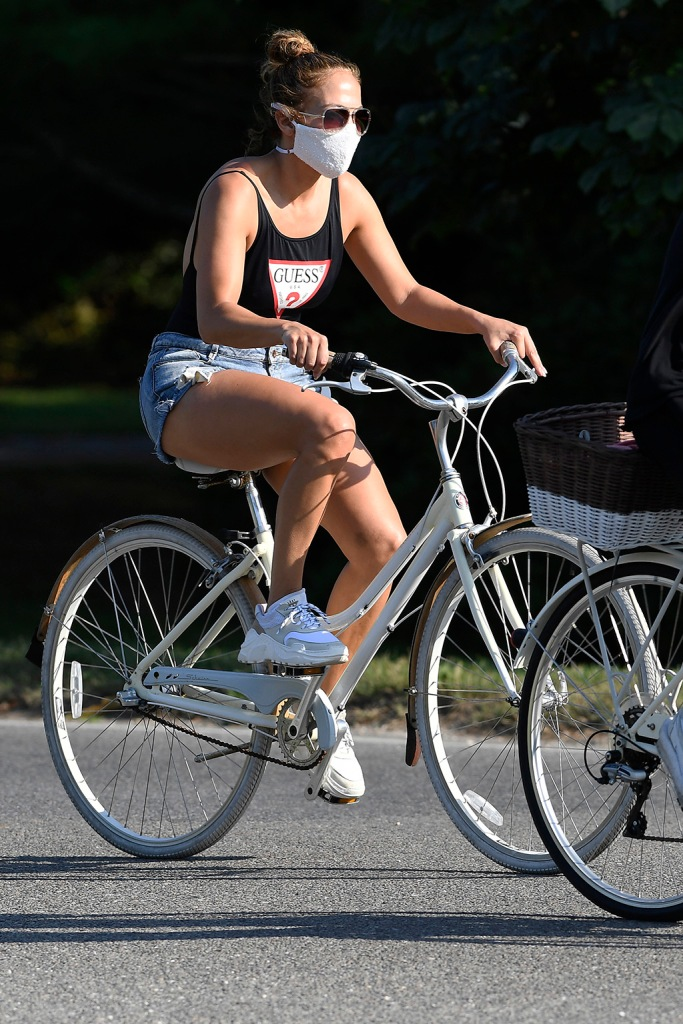 Jennifer Lopez, bathing suit, guess swimsuit, denim shorts, legs, last sprint sneakers, j-lo, street style, and her boyfriend Alex Rodriguez are photographed going for a bike ride in East Hampton 4th Of July weekendPictured: Jennifer LopezRef: SPL5175326 050720 NON-EXCLUSIVEPicture by: Elder Ordonez / SplashNews.comSplash News and PicturesUSA: +1 310-525-5808London: +44 (0)20 8126 1009Berlin: +49 175 3764 166photodesk@splashnews.comWorld Rights, No Poland Rights, No Portugal Rights, No Russia Rights
