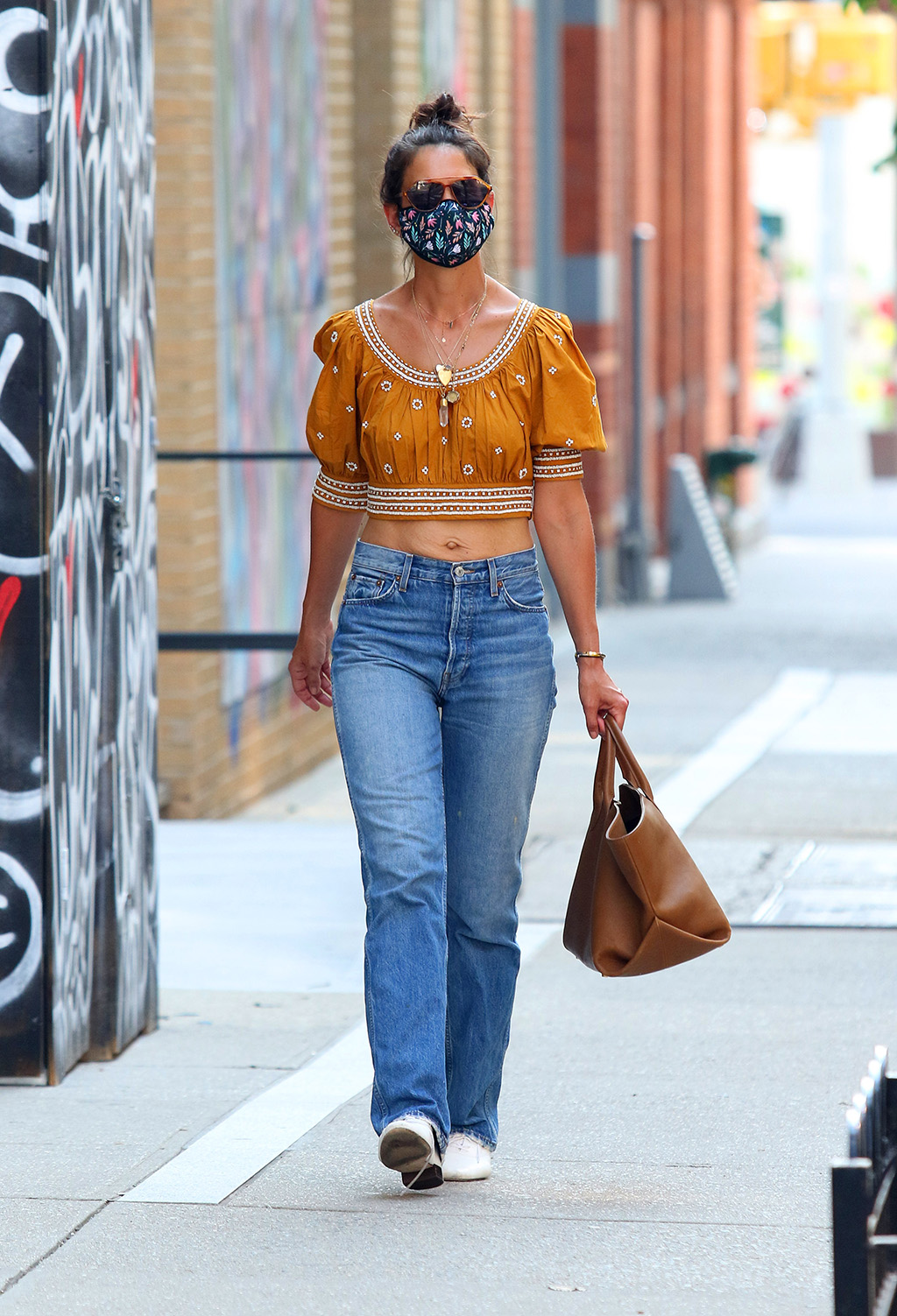 Katie Holmes, ulla johnson crop top, yellow shirt, abs, stomach, white lace-ups, mom jeans, khaite tote bag, floral mask, is seen on a hot humid day showing her toned midriff while sporting a colorful face mask as she went shopping in Manhattan's Soho area. 03 Jul 2020 Pictured: Katie Holmes. Photo credit: LRNYC / MEGA TheMegaAgency.com +1 888 505 6342 (Mega Agency TagID: MEGA686347_003.jpg) [Photo via Mega Agency]Katie Holmes is seen on a hot humid day showing her toned midriff while sporting a colorful face mask as she went shopping in Manhattan's Soho area. 03 Jul 2020 Pictured: Katie Holmes. Photo credit: LRNYC / MEGA TheMegaAgency.com +1 888 505 6342 (Mega Agency TagID: MEGA686347_001.jpg) [Photo via Mega Agency]