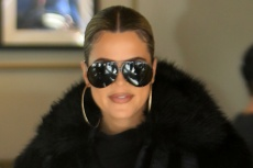 Khloé Kardashian Models Dramatic Boots from the New Good American Shoe Collection —Which Is Set to Debut This Week