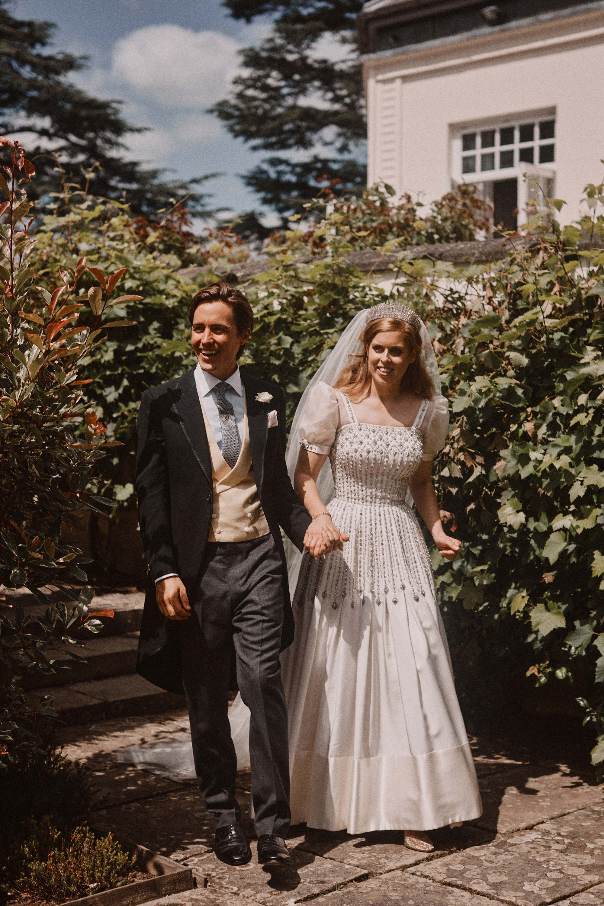 Official wedding photograph of Princess Beatrice and Edoardo Mapelli Mozzi after their wedding at The Royal Chapel of All Saints at Royal Lodge, Windsor, Berkshire, UK, on the 17th July 2020. Picture by Benjamin Wheeler/WPA-Pool NEWS EDITORIAL USE ONLY. NO COMMERCIAL USE. NO MERCHANDISING, ADVERTISING, SOUVENIRS, MEMORABILIA or COLOURABLY SIMILAR. NOT FOR USE AFTER 18th January 2021 WITHOUT PRIOR PERMISSION FROM BUCKINGHAM PALACE. NO CROPPING. The photograph must not be digitally enhanced, manipulated or modified in any manner or form and must include all of the individuals in the photograph when published. 17 Jul 2020 Pictured: Edoardo Mapelli Mozzi, Princess Beatrice. Photo credit: MEGA TheMegaAgency.com +1 888 505 6342 (Mega Agency TagID: MEGA689540_002.jpg) [Photo via Mega Agency]