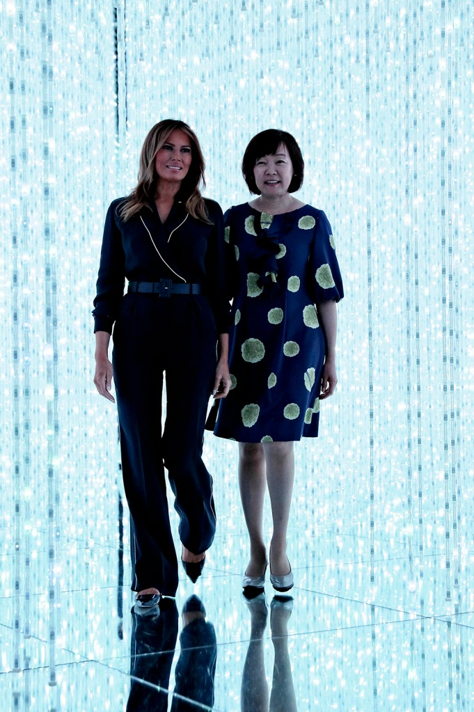 melania trump, loro piana jumpsuit, roger vivier flats, celebrity style, U.S. President Donald Trump's wife Melania Trump visits MORI Building DIGITAL ART MUSEUM with Japan's Prime Minister Shinzo Abe's wife Akie Abe in Tokyo on May 26, 2019. Trump will stay till May 28 as state guests. Trump is to play golf with Prime Minister Shinzo Abe and professional golfer Isao Aoki. The president is scheduled to watch sumo matches at Ryogoku Kokugikan, Tokyo, on same day evening, when the final day of the Summer Grand Sumo Tournament will be held, and present a special presidential cup to the winner of the tourney. He will then have dinner with Abe and his wife Akie at an izakaya pub in Tokyo. On the next day, Trump will meet with family members of Japanese nationals abducted by North Korea, after a summit meeting with the prime minister. The Emperor and Empress plan to meet with Trump and his wife prior to the summit meeting on May 27. The imperial couple will also visit Trump's accommodation in Tokyo on May 28, the last day of his visit schedule. ( The Yomiuri Shimbun via AP Images )