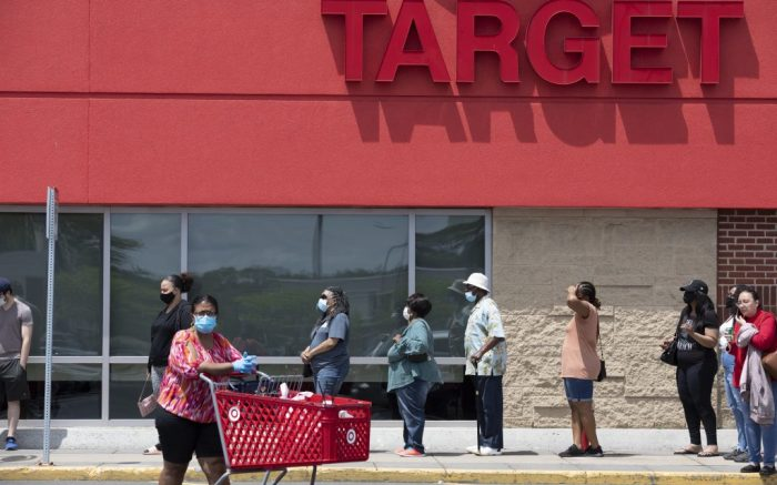 People in protective masks line up to enter a Target store, in BostonVirus Outbreak New England, Boston, United States - 30 May 2020