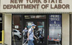 Pedestrians pass an office location for