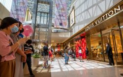 Due to social distancing, shoppers wear