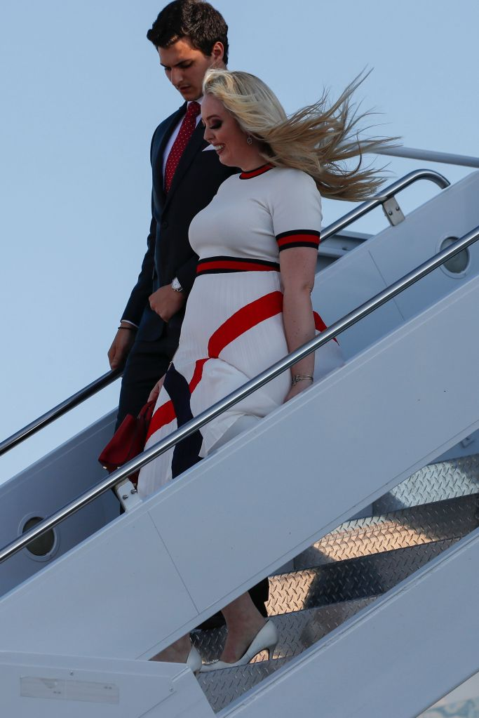 Tiffany Trump, ted baker dress, patriotic, red, white and blue, white pumps, and her boyfriend Michael Boulos walk as they arrive with President Donald Trump on Air Force One upon arrival at Ellsworth Air Force Base, S.D., . Trump is en route to Mount Rushmore National MemorialTrump Rushmore, Ellsworth Afb, United States - 03 Jul 2020